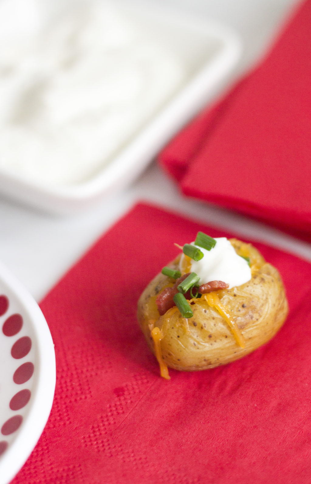 Holiday appetizer idea two bite baked potatoes the blondielocks 2 packages red and white mini potatoes 2 tin foil 3 cheddar cheese shredded 4 green onion or chives 5 sour cream 6 about 5 strips of bacon ccuart Choice Image