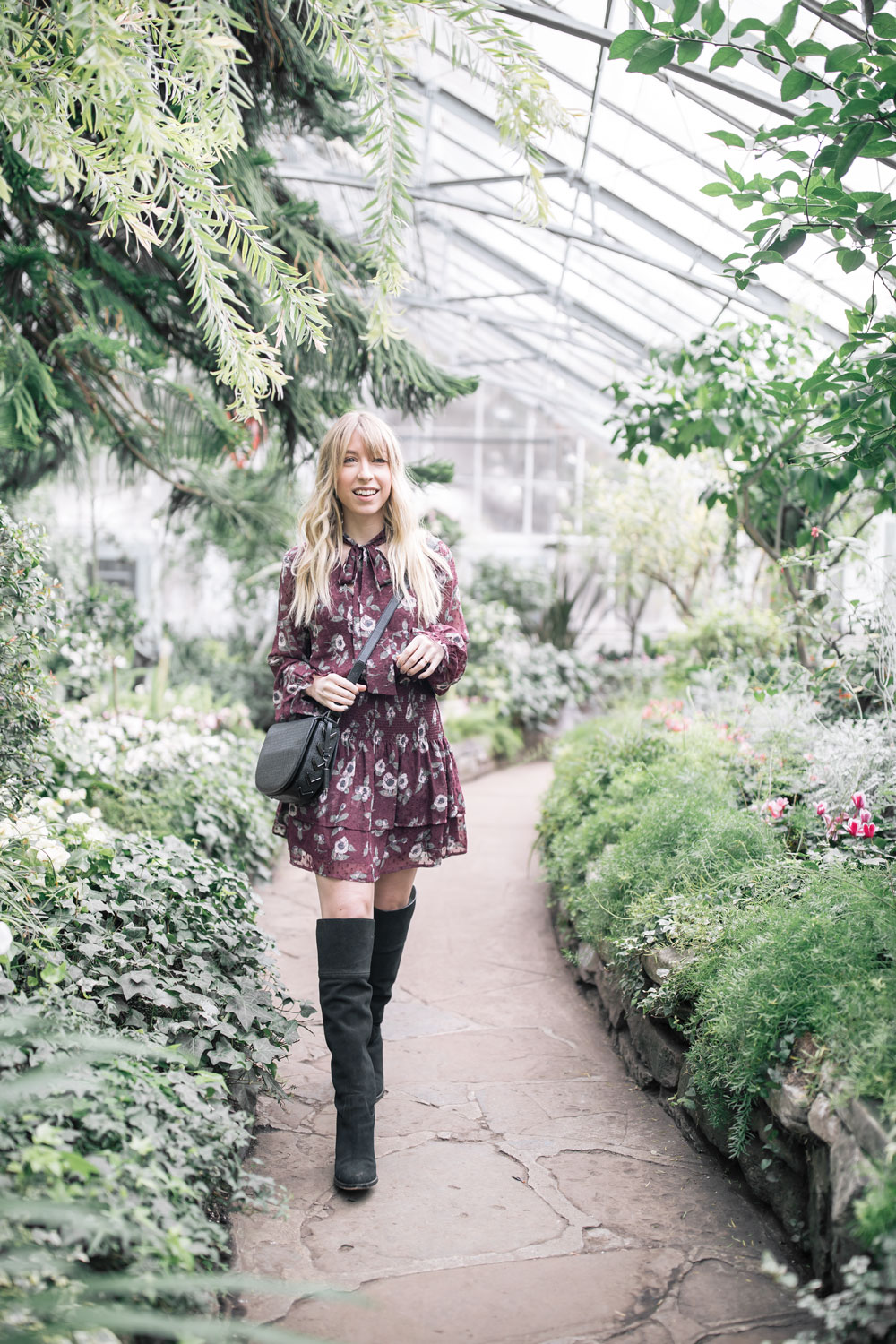 the blondielocks who is a toronto based lifestyle blogger is wearing a short smocked dress from nordstrom. moon river smocked dress. how to style over the knee boots.